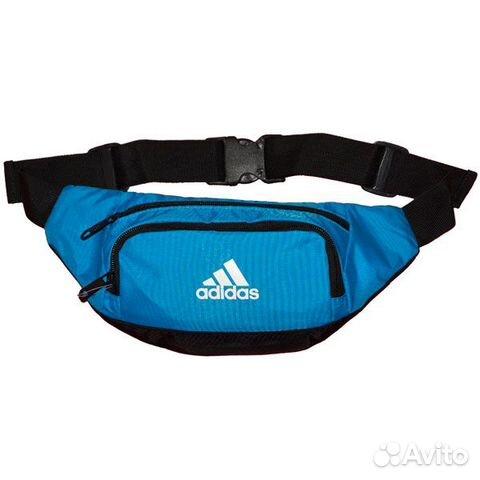 Спортивная сумка на пояс от известного производителя спортивной экипировки Adidas. .  Сумка имеет три отделения на...