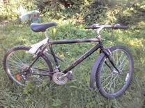 Велосипед чёрный.типа горного.шины нокиа